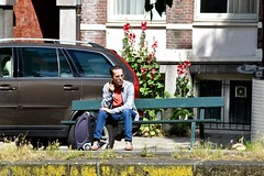 Waiting for the van to come - Amsterdam (FaceMePLS) Tags: amsterdam nederland thenetherlands facemepls nikond5500 straatfotografie streetphotography rolkoffer man sneakers bankje koffer trolley
