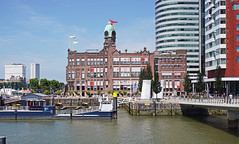 HAL station, hotel New York - Rotterdam (peter.velthoen) Tags: watertaxi halstationsgebouw wilhelminakade maas outdoor haven rotterdam architecture reizen hollandamerikaline waterfront building hotelnewyork city stad water rijnhaven havne buildingcomplex river