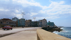 The Malecon (Alex L'aventurier,) Tags: lahavane habana cuba malecon coast ville city rue road street iurbain urban houses maisons sky ciel nuages clouds sea ocan ocean mer car voiture auto automobile vintage rouge red leadingline avenidademaceo esplanade l