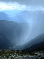 September snow shower over the Cheakamus Valley (Ruth and Dave) Tags: whistler whistlermountain whistlerblackcomb cheakamusriver cheakamusvalley coastmountains snow shower weather weatherphotography valley forested