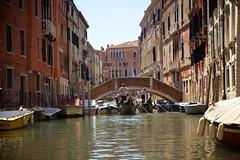 Peeking Down the Canal (cookedphotos) Tags: canon 5dmarkii travel italy venice venezia gondola water boat canal bridge gondolier
