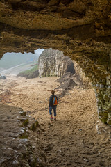 venturing out (stevefge (away travelling)) Tags: flamborough uk yorkshire bay sand beach cave sea arch people
