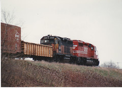Going away..... (MILW157) Tags: road milwaukee gondola 1991 boxcar bandit soo 498 nashotah sd402 gp40