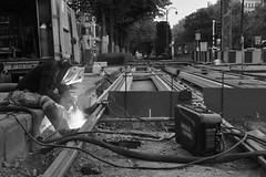 The man in the mask. (Azariel01) Tags: light brussels work blackwhite belgium belgique belgie lumière bruxelles tram sparks chantier welder stib 2015 avenuelouise mivb soudeur defacqz louizalaan eteincelles