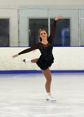 Skater in Black-n-Silver 3 (R.A. Killmer) Tags: skill smile skate skater ice beauty performer performance blades fast glide spin jump form pretty precision
