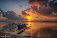 the new beginning (siswanto_p) Tags: bali sanur sunrise sun clouds sky boat beach reflection