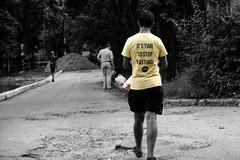 true (pyrin.oleksandr) Tags: man t short yellow walk strret bw black white boy