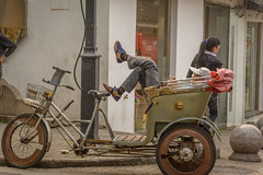 taking a break 1 (stevefge (away for a few days)) Tags: shanghai watertown suzhou transport bikes bicycles rikshaw people men break rest street candid reflectyourworld china