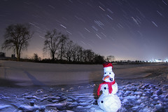 The Guardian of the Night (Radical Retinoscopy) Tags: longexposure nightphotography snow lightpainting man night stars snowman astrophotography lancaster astronomy nightsky lancastercounty startrail canoneost2i canon815mm starstax