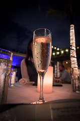 celebration (almostsummersky) Tags: water glass palms menu table lights restaurant spring candle florida miami champagne bubbles flute tablecloth bubbly redfishgrill