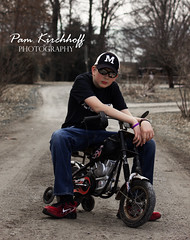 Bad to the Bone (Pamala K) Tags: boy portrait guy monochrome bicycle training pose outside outdoors cool funny humorous lol country wheels humor hard monochromatic teen lane teenager biker motorcyle