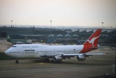 Qantas 747 'VH-EBV' (Longreach - Jonathan McDonnell) Tags: manchester 1988 scan boeing qantas 1980s 747 nikoncoolscanved 747300 scanfromaslide 747338 vhebv