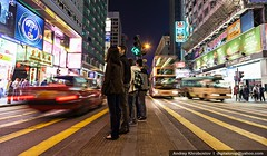 Pedestrians crossing road in Hong Kong (digitalcrop) Tags: life china road street city travel light people urban motion color building walking asian person hongkong movement asia downtown day cityscape crossing view cross traffic action walk contemporary centre crowd transport group central chinese pedestrian scene junction hong kong business busy rush hour transportation zebra vehicle commuter intersection crosswalk stress