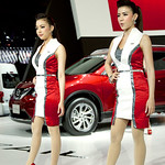 Sexy Nissan presenters with X-Trail in the back at the 36th Bangkok International Motor Show thumbnail