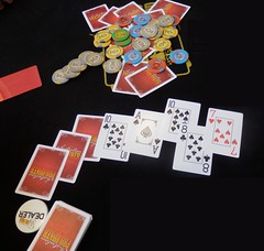 Table with cards, chips and dealers button