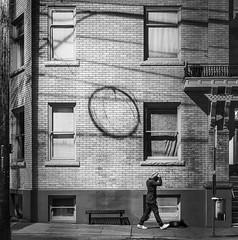 O (Doug Knisely) Tags: seattle street man brick window silhouette walking nikon grafitti shadows loop balcony pedestrian coil apartmentbuilding capitolhill d600 madisonst 8518g themadkin
