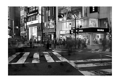 Shinjuku crossings (PavelTitov) Tags: street urban blackandwhite monochrome japan night tokyo shinjuku cityscape crossing availablelight ricohgr mts