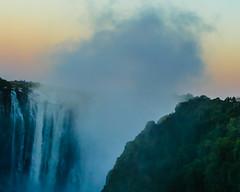Smoke That Thunders (MarcCooper_1950) Tags: bridge sunset mist signs water river lumix waterfall dusk spray panasonic zimbabwe zambia plume lightroom livingstone southernafrica zimzam victoriafallsbridge vicoriafalls marccooper fz1000 royalivingstoneexpress