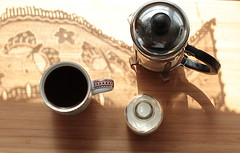 Early morning mindfulness (zinnia2012) Tags: shadows light reflections lacecurtains coffee cup coffeepot creambottle caf dentelle ombreetlumire