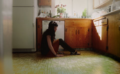 sometimes i sit around on yer kitchen floor eating lucky charms with the ants and the scabby cats wondering what i put my hand in a puddle of (roadkill rabbit) Tags: girl kitchen floor weird light linoleum california