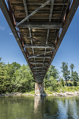 Under the Bridge (The Wandering Cameraman) Tags: d750 shapes contrast metal wood structure water walkway bridge footbridge ottercreek middlebury vermont middleburyvermont outdoors perspective reflections marbleworks rust weathered