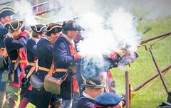 The Fog of Battle (Wes Iversen) Tags: cassrivercolonialencampment frankenmuth hss michigan nikkor18300mm sliderssunday gunfire guns men painterly reenactments reenactors smoke hats