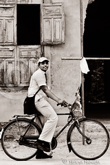 Schoolboy Smiling (Hiranya Malwatta) Tags: srilanka lanka bw blackandwhite jaffna boy schoolboy bicycle people culture