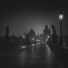 Dawn on Charles Bridge (Vesa Pihanurmi) Tags: charlesbridge night bridge prague praha cobblestone road lanterns lamppost statues sculpture tower spires cityscape street karlvmost monochrome blackandwhite streetphotography