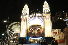 Luna Park (lukedrich_photography) Tags: australia oz commonwealth        newsouthwales nsw canon t6i canont6i history culture sydney       metro city night light dark longexposure luna park milsons point harbour amusement attraction ride entertainment register national estate heritage state entrance face ferriswheel rotor