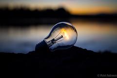 Let there be light (petrisalonen) Tags: bulb landscape light sunset river finland nature sunrise
