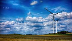 Ride the Wild Wind. (Jean McLane) Tags: clouds nubes nuages eolienne blue bleu azul landscape