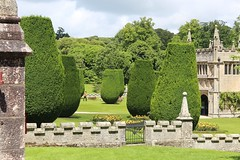 Photo of Lanhydrock - yews and gatehouse