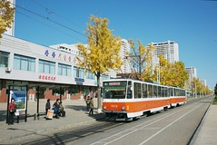 Tatra tram on Tongil street (Frhtau) Tags: dprk north korea station building economy modernisation new korean people leute asia asian east nordkorea passers architecture gebude architektur design scenery   choxin  outdoor      corea del norte core du nord coreia do coria    culture stadt gebudekomplex pyongyang capital city tongil street strasse scene szene tram tatra strassenbahn