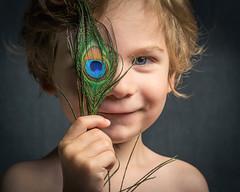 359/365 - Blue Eyes (kate.millerwilson) Tags: peacock feather boy child blond blueeyes strobist flash alienbees angryphotographer homestudio