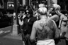 Great stories on her Back. (kogh65) Tags: new york photography photo travel art 2016 nyc ny street black white leica m mono tone city outdoor life people depth field reportage young kogh candid camera focus pov picture 50mm image manhattan artist kogh65 tattoo