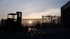 Low Sun and Silhouettes. .. (christianiani) Tags: sunset sky colour beautiful sunshine silhouette photography evening early photo spring warm view shot gorgeous awesome horizon low clear devon friday railings forklift paignton