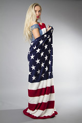Shayla (austinspace) Tags: portrait woman usa proud studio washington spokane flag patriotic blond bow blonde hunter carhartt alienbees bowhunter