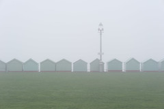 Beach huts in the fog (Laurence Cartwright) Tags: uk england mist sussex photo brighton hove promenade laurencecartwright