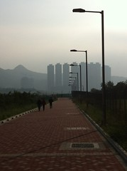 walk toward Lohas Park (Winedemonium2) Tags: street urban apple landscape smog haze o 4 hong kong walkway lamps verticality kwan iphone tseung iphone4