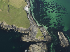 Knowe of Skea on Westray, Orkney Islands 2009 showing a possible broch and excavation (Historic Environment Scotland) Tags: dp068327 knoweofskea westray orkneyislands 2009 historicenvironmentscotland hes aerial aerialphotograph rcahms canmore scotland broch archaeology prehistoric