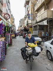 .  (Ayman Abu Elhussin) Tags: street old people man bicycle egypt streetlife portsaid arab sell seller determination  streetshot  2016       peoole          portsaidegypt         aymanabuelhussin nikon7100   sharkyast