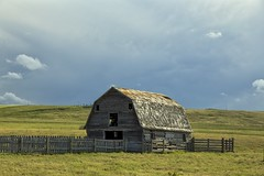 Barn Storm fence (John Andersen (JPAndersen images)) Tags: blue sky white canada mountains clouds barn fence rockies canadian alberta