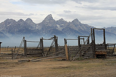 Derelict Corral and the Tetons (David C. McCormack) Tags: ranch mountains west rural forest fire smoke western rockymountains wyoming grandteton corral grandtetonnationalpark