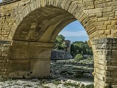 View through the arch of Pont du Gard near Nimes, France Roman 1st century CE (mharrsch) Tags: arch aqueduct architecture engineering roman bridge unesco pontdugard france ancient mharrsch