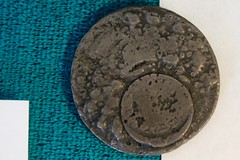 Dime Melted Into a Silver Dollar (Piedmont Fossil) Tags: peshtigo wisconsin fire museum melted coins artifact