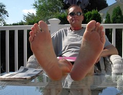 Deciding how to spend the day (nwdcguy1) Tags: malefeet soles barefoot