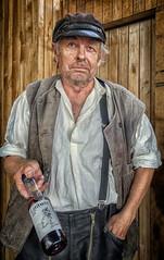 Whisky galore (Dale Michelsohn) Tags: whisky woodsman swedish old portrait cap worker farmer man dalemichelsohn canon powershot g5x street city