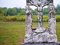 On the cross (Jamie McCaffrey) Tags: 2016 canada cemetery cross crucifixion fallowfieldroad fuji fujifilm grave graves headstone jesus nepean ontario ottawa rain rainy stpatrickschurch summer xt1
