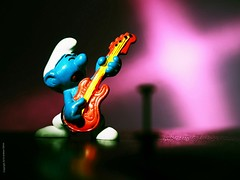 """12-bar screaming guitar solo in """"The Smurf Song"""" (P'sych) Tags: olympus60mmmacrolens macro smurf guitar solo nissini40x2 fphighspeedflash whimsy flashgel"""