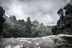 On the edge of the waterfall (wianphoto) Tags: jungle olympusomdem5markii laos wianphoto omdem5markii cloudy water image stones clouds river trees summer nature impressive tree olympusmzuiko1240mm forest asien sunny sky fog olympuspro1240mm omdem5mark2 asia waterfall